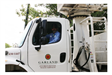 Worker Driving an Environmental Waste Service Truck