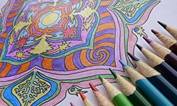 A coloring page with colored pencils